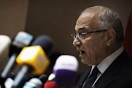 Egyptian presidential candidate and former prime minister Ahmed Shafiq speaks at a press conference in Cairo. Shafiq pledged Saturday to restore the country&#39;s revolution