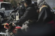 Chinese police patrol a street in China's Qinghai province on March. Up to 20 Tibetan students in Qinghai were hospitalised after police and security forces arrived at a protest apparently over the school booklets Monday, Free Tibet said