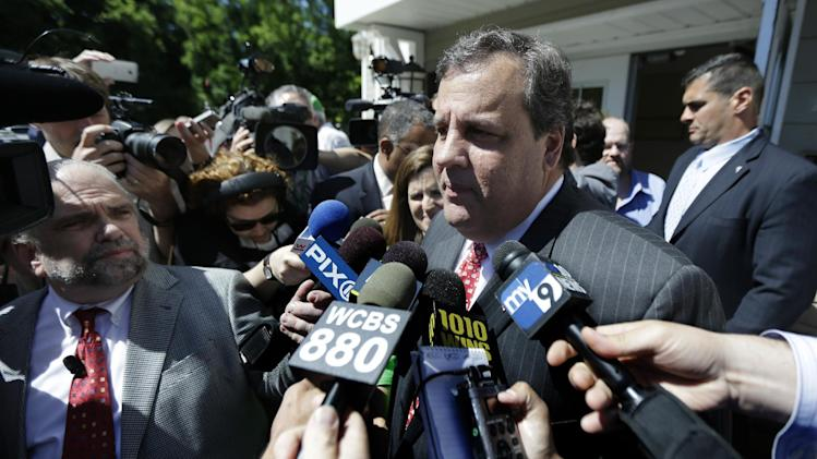 New Jersey Gov. Chris Christie talks to the press after casting his primary election vote, Tuesday, June 4, 2013, in Mendham Township, N.J. (AP Photo/Julio Cortez)