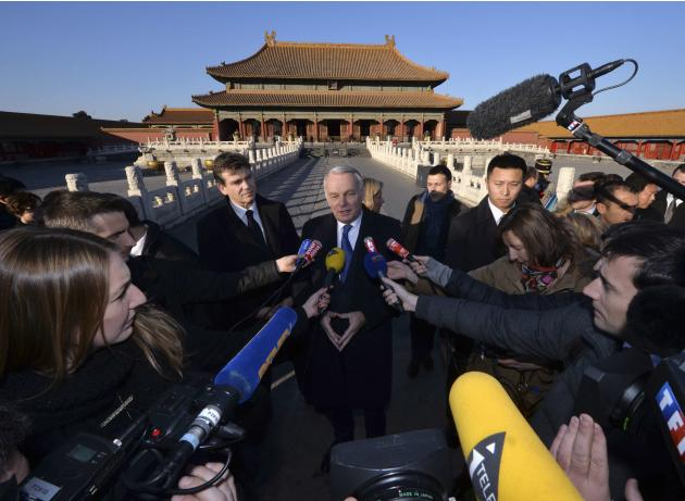 French Prime Minister Jean-Marc Ayrault speaks to the media as he tours the historic Forbidden City at the start of his visit to Beijin
