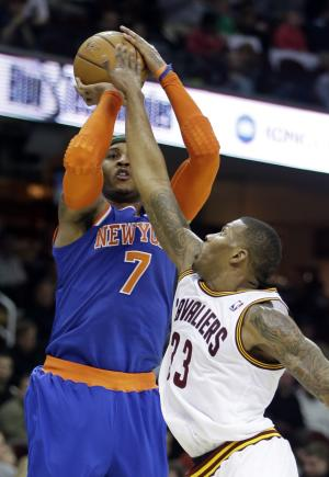 New York Knicks' Carmelo Anthony (7) shoots over Cleveland Cavaliers' Alonzo Gee in the third quarter of an NBA basketball game on Friday, April 12, 2013, in Cleveland. Anthony scored 31 points in the Knicks' 101-91 win. (AP Photo/Mark Duncan)