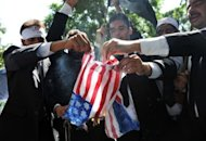 "<p>Pakistani lawyers burn a US flag as they attempt to reach the US embassy in the diplomatic enclave during a protest against an anti-Islam movie in Islamabad on September 19. More than 30 people worldwide have died in incidents linked to the trailer for ""Innocence of Muslims,"" a US-made film that depicts the Prophet Mohammed as a thuggish womaniser.</p>"