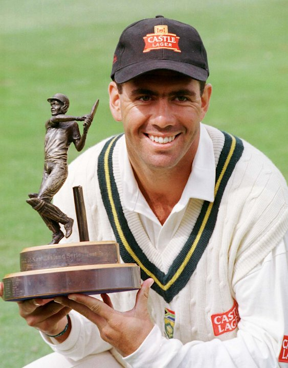 South Africa's capatin, Hansie Cronje holds the Ba