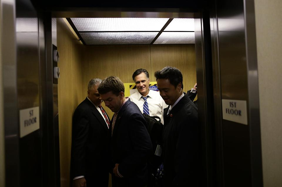 Republican presidential candidate and former Massachusetts Gov. Mitt Romney, aide Garret Jackson, second left, and U.S. Secret Service agents get into an elevator as they arrive at their hotel for the evening in Mansfield, Ohio, Sunday, Oct. 28, 2012. (AP Photo/Charles Dharapak)