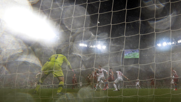 Heavy rain falls during the Euro 2012 soccer championship Group A match between Czech Republic and Poland in Wroclaw, Poland, Saturday, June 16, 2012. (AP Photo/Jon Super)