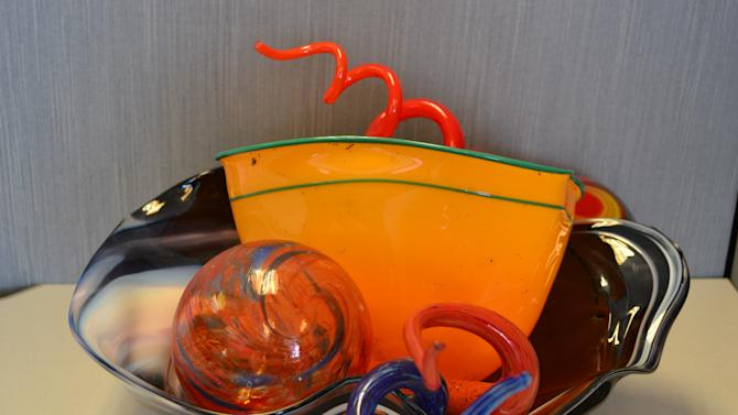 In this undated photo provided by U.S. Immigration and Customs Enforcement, a counterfeit Dale Chihuly glass sculpture is displayed. The sculpture is one of many fakes sold by Michael Little, of Renton, Wash., who was sentenced to five months in prison for wire fraud Wednesday, Nov. 20, 2013. Little admitted he sold more than $22,000 worth of counterfeit art to a collector who planned to donate the pieces to the art museum at Gonzaga University. Chihuly is a famed American glass artist whose work has been displayed around the world.(AP Photo/U.S. Immigration and Customs Enforcement)