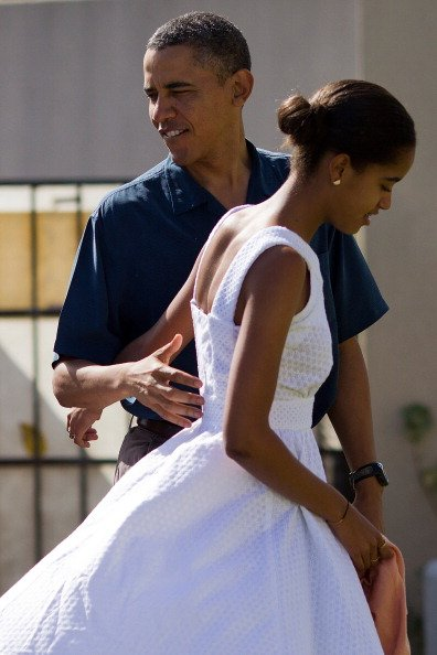 U.S. President Barack Obama and his daughter Malia Obama prepare to enter the Marine Corps Base Hawaii Chapel December 25, 2011 in Kaneohe, Hawaii. Obama is spending the Christmas holiday in his nativ