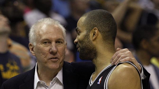 San Antonio Spurs head coach  Gregg Popovich, left,  talks to San Antonio Spurs guard Tony Parker, of France, during a timeout in the first half of Game 4 of the Western Conference finals NBA basketball playoff series against the Memphis Grizzlies, in Memphis, Tenn., Monday, May 27, 2013. (AP Photo/Danny Johnston)