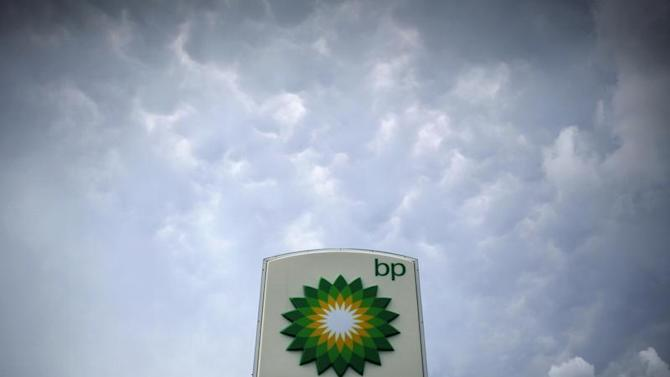 Storm clouds form near a BP station in Alexandria, Virginia