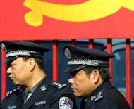 File photo of Chinese police officers in the southern city of Guangzhou. The death of a Nigerian man in police custody in China's southern city of Guangzhou sparked a violent protest by hundreds of people, state media and police said