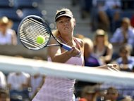 Maria Sharapova of Russia returns to Mallory Burdett of the US during their 2012 US Open women's singles match at the USTA Billie Jean King National Tennis Center in New York. Sharapova won 6-1, 6-1