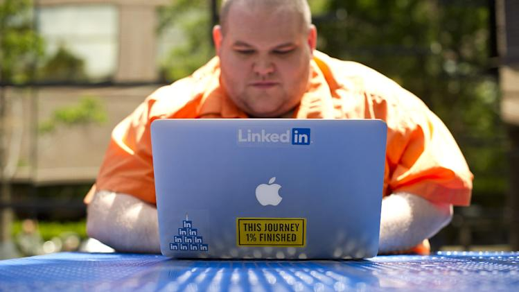 This Tuesday, May 7, 2013, photo, Greg Leffler, a site reliability engineer at LinkedIn, works outside his company's Mountain View, Calif., headquarters. LinkedIn and Facebook celebrate the anniversaries of their IPOs just a few days apart this week. But the companies' experiences as publicly traded entities couldn't be more different. LinkedIn promotes its service as a stepping stone to a more enriching career. As it turns out, the professional networking company's IPO was a great place to start a rewarding investment portfolio, too. LinkedIn's stock has nearly quadrupled in value from its $45 IPO price two years ago. (AP Photo/Noah Berger)