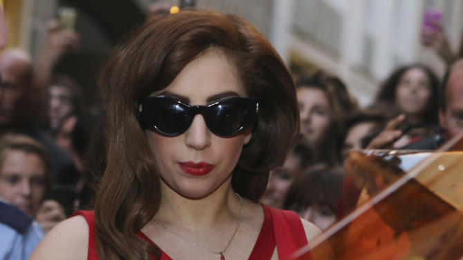 US performer Lady Gaga arrives at the Versace atelier in Milan, Italy, Moday, Oct. 1, 2012. Lady Gaga will stage the only Italian concert of her tour in Milan Tuesday. (AP Photo/Luca Bruno)
