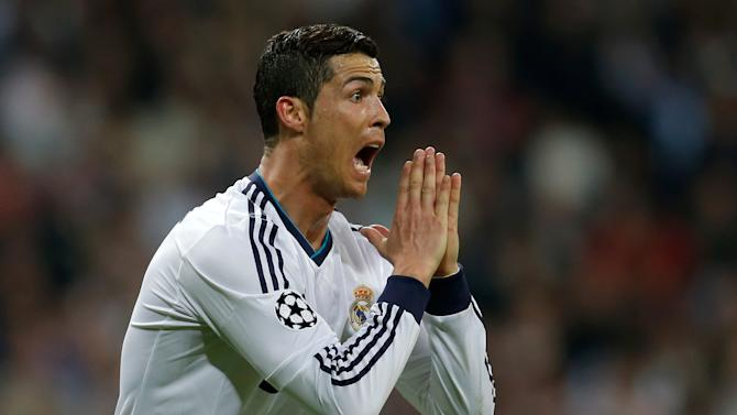 Real Madrid's Cristiano Ronaldo from Portugal reacts during the Champions League semifinal second leg soccer match between Real Madrid and Borussia Dortmund at the Santiago Bernabeu stadium in Madrid, Spain, Tuesday April 30, 2013. (AP Photo/Paul White)