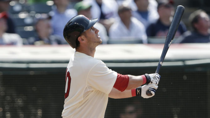Cleveland Indians' Yan Gomes watches his ball after hitting a game-winning three-run home run off Seattle Mariners relief pitcher Charlie Furbush in the tenth inning of a baseball game, Monday, May 20, 2013, in Cleveland. Michael Brantley and Drew Stubbs scored. The Indians won 10-8. (AP Photo/Tony Dejak)