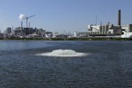 This Sept. 12, 2012 photo shows a water purifying lagoon the Archer Daniels Midland company plant in Decatur, Ill. While companies in the Great Lakes region and other parts of middle America long counted on water being cheap and plentiful, they now realize they must conserve because finding new water sources is difficult and expensive - if it can be done at all. (AP Photo/Seth Perlman)