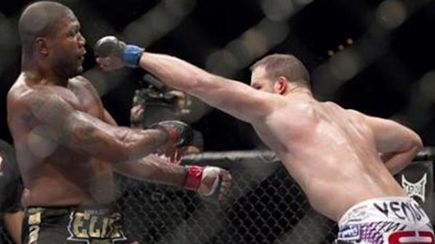 Matt Hamill, right, throws a punch at Quinton Jackson