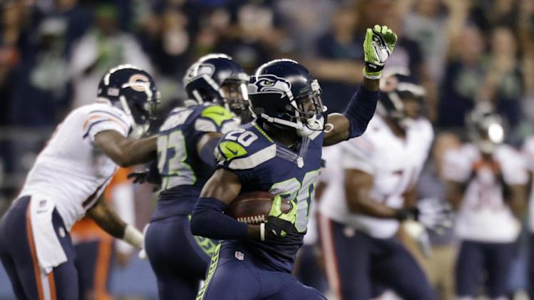 Seattle Seahawks' Jeremy Lane (20) runs after intercepting a Chicago Bears pass late in the first half of a preseason NFL football game, Friday, Aug. 22, 2014, in Seattle. (AP Photo/John Froschauer)