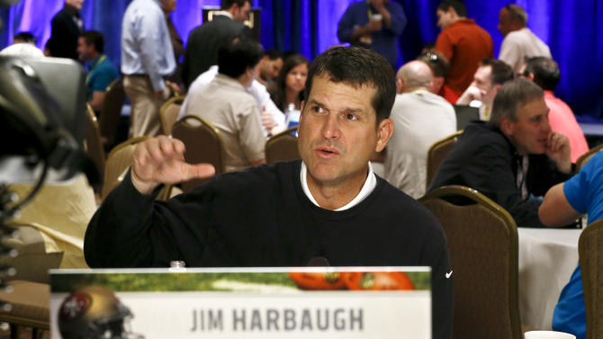 San Francisco 49ers head coach Jim Harbaugh answers a question from the media during the NFC coaches breakfast at the annual NFL football meetings at the Arizona Biltmore, Wednesday, March 20, 2013, in Phoenix. (AP Photo/Ross D. Franklin)