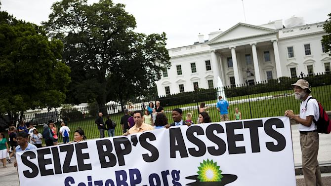 """FILE- In this Tuesday, June 15, 2010, file photo, a group called """"Seize BP"""" holds up an anti-BP sign in front of the White House, in Washington. The Obama administration put a temporary stop to new federal contracts with British oil company BP on Wednesday, Nov. 28, 2012, citing the company's """"lack of business integrity"""" and criminal proceedings stemming from the Deepwater Horizon disaster in 2010. (AP Photo/Drew Angerer, File)"""