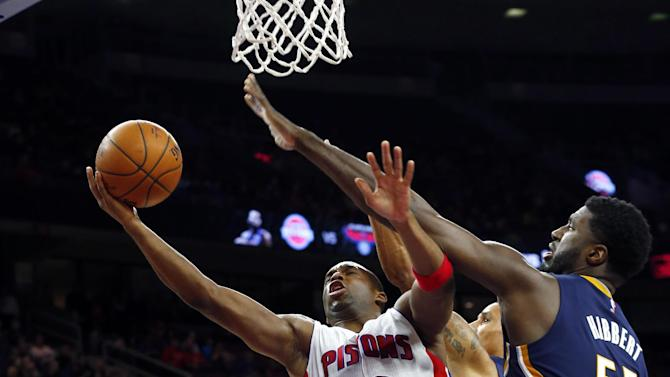 Detroit Pistons guard Jodie Meeks (20) drives against Indiana Pacers center Roy Hibbert (55) in the second half of an NBA basketball game in Auburn Hills, Mich., Friday, Dec. 26, 2014. (AP Photo/Paul Sancya)
