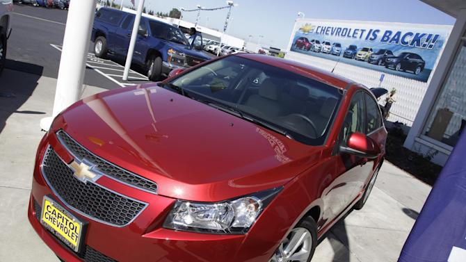 In this Aug. 30, 2011 photo a 2011 Chevrolet Cruze is featured at a car dealership in San Jose, Calif. General Motors' car and truck sales rose 18 percent last month as fuel-efficient vehicles helped offset a roiling stock market and Hurricane Irene. (AP Photo/Paul Sakuma)