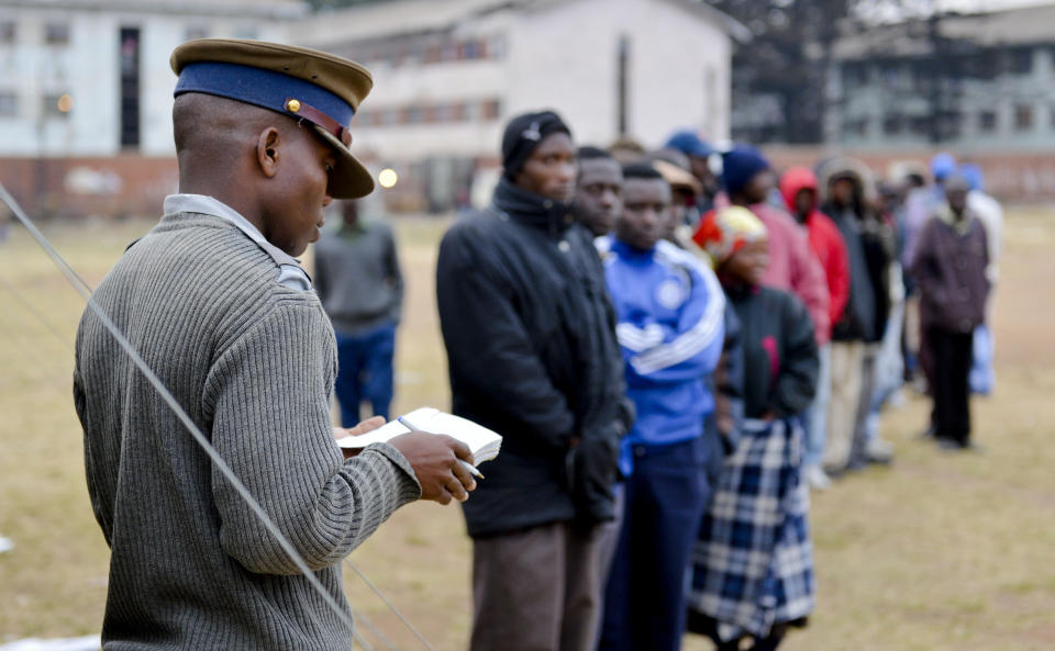 Voters queue to cast their ballots in elections in Mbare, Harare, Zimbabwe, early Wednesday July 31, 2013. Zimbabweans voted Wednesday in the elections that will determine the future of longtime President Robert Mugabe, who has denied allegations of vote-rigging despite concerns about the credibility of the polls. (AP Photo)