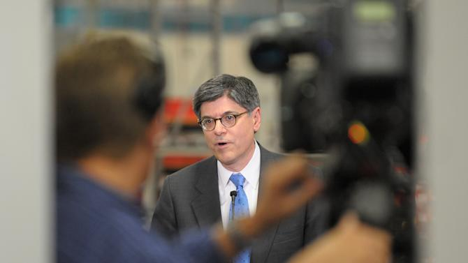 Treasury Secretary Jacob Lew speaks after touring the Siemens manufacturing plant where electrical drive components for heavy machinery are assembled in Alpharetta, Ga., Thursday, March 14, 2013. The facility produces large traction drive trains for customers including AMTRAK, Caterpillar and the new Atlanta Streetcar initiative. (AP Photo/David Tulis)