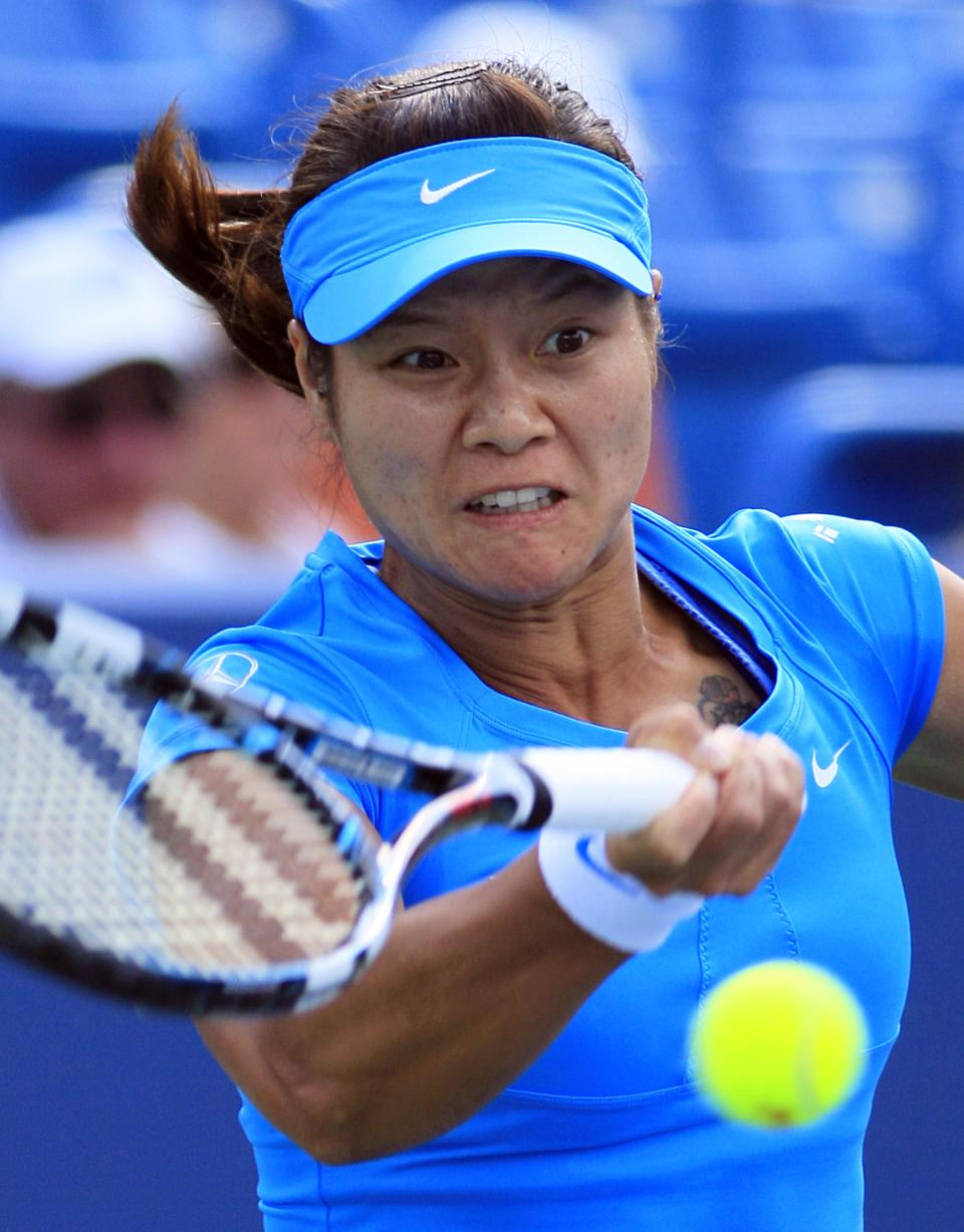 Li Na, of China, hits a forehand against Angelique Kerber, of Germany, during the women's final at the Western & Southern Open tennis tournament, Sunday, Aug. 19, 2012, in Mason, Ohio. Na won 1-6, 6-3, 6-1. (AP Photo/Al Behrman)