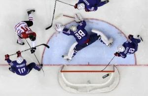 France's goalkeeper Huet defends during the men's ice hockey World Championship Group A game against Canada at Chizhovka Arena in Minsk