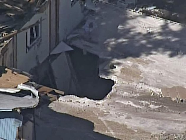 In this video image provided by ABC Action News-WFTS TV, shows an aerial photo of a sinkhole Monday, Mar. 4, 2013, in Seffner, Fla. The hole opened up underneath a bedroom late Thursday evening and sw