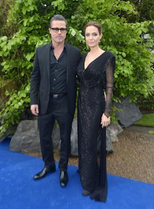 Actors Brad Pitt and Angelina Jolie arrive at the Maleficent exhibit in Kensington Gardens, London, Thursday, May 8, 2014. The exhibit showcases some of the costumes and props from the film Maleficent, before they go on display to the public at the O2 in London.(Photo by Jon Furniss/Invision/AP Images)