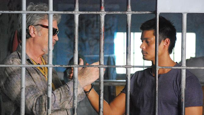 """In this handout photo taken March, 2010 and released by Portfolio Films Wednesday, April 3, 2013, Irish actor Patrick Bergin, left, and Filipino heartthrob Dingdong Dantes perform during a scene at the Cebu Provincial Detention and Rehabilitation Center in Cebu province, central Philippines. The Filipino inmates whose choreographed """"Thriller"""" dance has attracted 52 million YouTube hits since 2007 are getting their own stories told in a movie """"Dance of the Steel Bars"""". (AP Photo/Portfolio Films) NO SALES"""