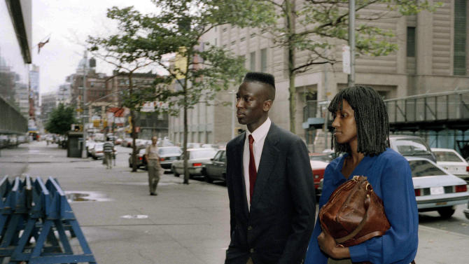 FILE - In this Aug. 11, 1990 file photo, Yusef Salaam enters State Supreme Court in Manhattan with his mother, Sharonne Salaam, on the third day of deliberations in the Central Park jogger trial. Salaam and four other teenage boys maintained their innocence as they grew up behind bars after being convicted in the rape and brutal beating of a jogger. Their convictions were eventually tossed out by a judge when new evidence surfaced linking someone else to the crime. But their legal battle goes on: A $250 million federal lawsuit against police and prosecutors has been pending nearly a decade, with no resolution in sight. (AP Photo/Phillip Schoultz, File)