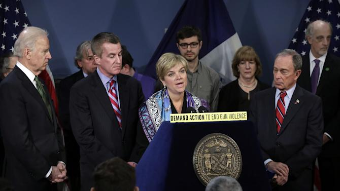 Vice President Joe Biden, left, Chris McDonnell, second from left, and others, listen as McDonnell's  wife Lynn McDonnell, whose daughter Grace was killed in Newtown, Conn., speaks in New York's City Hall Blue Room, Thursday, March 21, 2013. Relatives of shooting victims from Newtown, Conn., stood with New York Mayor Michael Bloomberg, second from right, and Biden as they spoke in favor of an assault weapons ban. (AP Photo/Richard Drew)