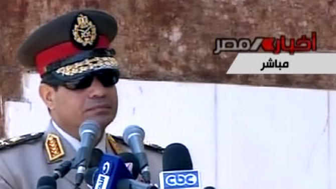 "In this image taken from Egypt State TV, Egyptian Defense Minister Gen. Abdel-Fattah el-Sissi delivers a speech in Alexandria, Egypt, Wednesday, July 24, 2013. El-Sissi has called on Egyptians to hold mass demonstrations to voice their support for the military to put an end to ""violence"" and ""terrorism.""( AP Photo/Egypt State TV)"
