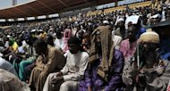 People attend a prayer ceremony organised by religious leaders for peace in Mali. More than 25,000 heeded a call from Christian and Muslim leaders to join a peace rally at a stadium in the capital