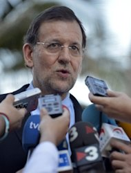 "<p>Spanish Prime Minister Mariano Rajoy talks to members of the media upon his arrival at his hotel in Los Cabos, on June 17, on the eve of G20 meeting. Rajoy demanded ""urgent"" action by the European Union to calm market tension, in a letter to its leaders at the start of June.</p>"