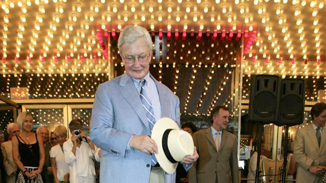 FILE - This July 18, 2005 file photo shows film critic Roger Ebert next to a sidewalk medallion bearing his name that was unveiled under the marquee of the historic Chicago Theatre. The Chicago Sun-Times is reporting that its film critic Roger Ebert died on Thursday, April 4, 2013. He was 70.  (AP Photo/Charles Rex Arbogast, file)
