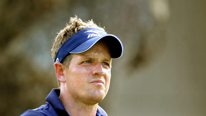Luke Donald, of England, reacts after hitting his drive off the third tee into the rough during the final round of the RBC Heritage golf tournament in Hilton Head Island, S.C., Sunday, April 15, 2012. (AP Photo/Stephen Morton)