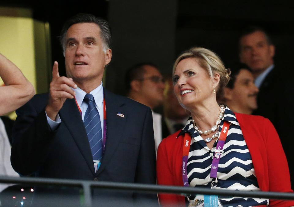 U.S. Republican Presidential candidate Mitt Romney, left, and his wife Ann arrive for the Opening Ceremony at the 2012 Summer Olympics, Friday, July 27, 2012, in London. (AP Photo/Jae C. Hong)