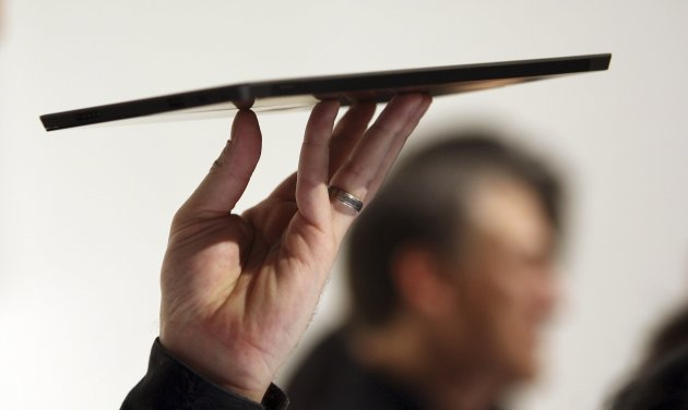 A Microsoft representative holds the new Surface as it is unveiled by Microsoft in Los Angeles