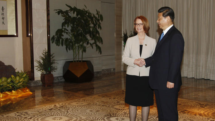 Chinese President Xi Jinping, right, shakes hands with Australia's Prime Minister Julia Gillard during their meeting in Boao town, Hainan province, Sunday, April 7, 2013. (AP Photo/Tyrone Siu, Pool)
