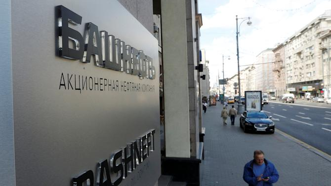 People walk past headquarters of Russian state-owned oil producer Bashneft in Moscow