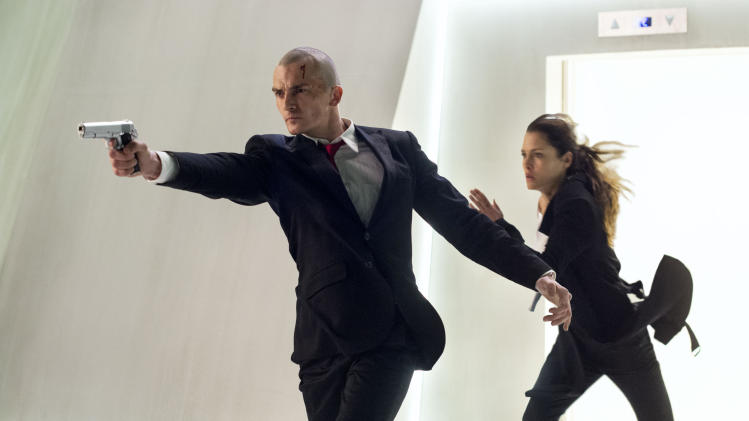"This photo released by Twentieth Century Fox shows, Rupert Friend, left, as Agent 47, and Hannah Ware as Katia, in a scene from the film, ""Hitman: Agent 47."" (AP Photo/Twentieth Century Fox, Reiner Bajo)"
