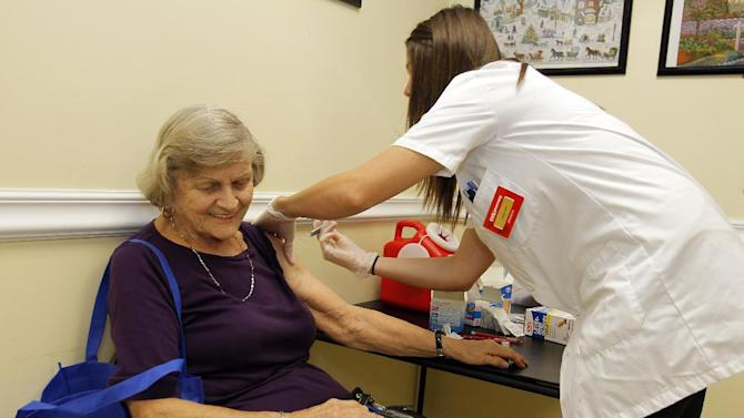 Julianne Crain  gets her flu shot at a flu clinic at  the Boynton Beach Senior Center as part of the Flu + You initiative led by AAA to educate adults 65 and older about the seriousness of the flu and the available vaccine options for this age group at the Boynton Beach Senior Center in Boynton Beach, Florida on September 13,2012. (Tom DiPace /AP Images for National Council on Aging (NCOA)