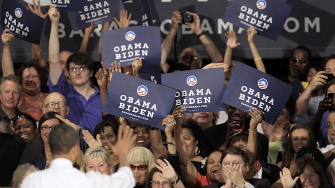 President Barack Obama waves to supporters after speaking at the John S. Knight Center Wednesday, Aug. 1, 2012, in Akron, Ohio. Obama is campaigning in Ohio with stops in Mansfield and Akron today. (AP Photo/Tony Dejak)