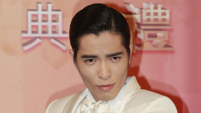FILE - In this July 6, 2013 file photo, Taiwanese singer Jam Hsiao gestures upon arrival for the 24th Golden Melody Awards in Taipei, Taiwan. The 26-year-old singer told reporters Tuesday, Oct. 29, 2013 that two motorcyclists approached his van asking for autographs before the attack. He said his driver was hit and suffered bruises while pursuing the motorcyclists, but Hsai himself was unharmed.(AP Photo/Wally Santana, File)