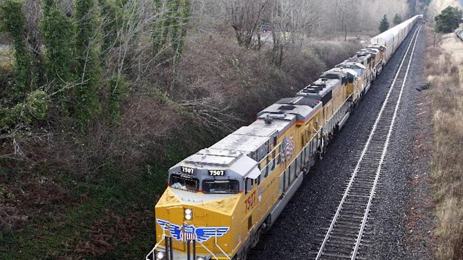 FILE - This Jan. 4, 2012, file photo shows a Union Pacific train as it goes through a tunnel along the Columbia Gorge near Bridal Veil, Ore. Union Pacific Corporation on Thursday, April 19 reported 2012 first quarter net income of $863 million, or $1.79 per diluted share, compared to $639 million, or $1.29 per diluted share, in the first quarter 2011. (AP Photo/Rick Bowmer, File)