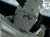 In this frame grab from a NASA video, the SpaceX Dragon capsule is seen docked to the International Space Station May 25. SpaceX became the first commercial outfit to send its own cargo capsule to the International Space Station, heralding the start of a new era for private spaceflight